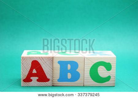 English Abc Letters On Wooden Toy Blocks. Letters Of The English Alphabet Learn Foreign Languages. E