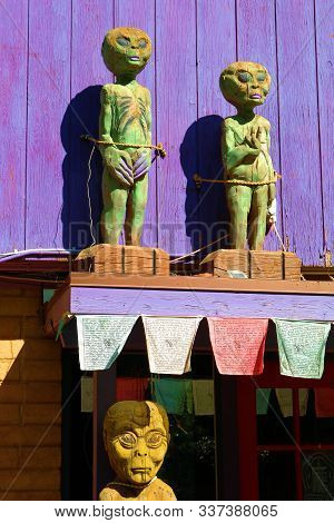 October 16, 2019 In Sedona, Az:  Tibetan Prayer Flags Hanging Besides Alien Art Sculptures At The En