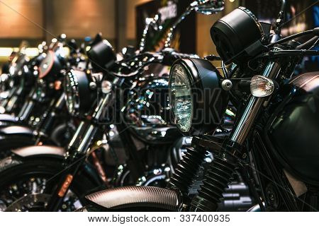 Close Up Detail Of Headlights And Chrome Parts Of Motorbikes, Brand New Motorcycles Parked In A Row,
