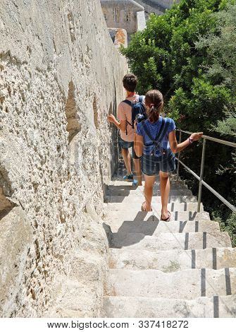 Steep Stairway Of Fortress Of Bonifacio In Corsica Island And Some Children