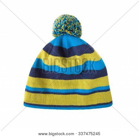 Striped Blue And Yellow Knit Cap With Pom-pom Isolated On White Background. Wooly Beanie Hat For Ski