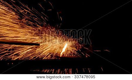 Gas Metal Cutting With Acetylene Or Oxygen Torch. Bright Sparks And Smoke From Exothermic Reaction B
