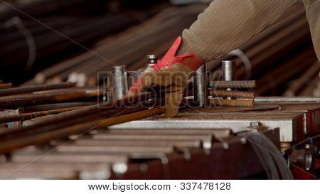 Worker Man Specialist In Gloves Using Roller Bender Machine Tool . Industrial Bender Equipment Machi