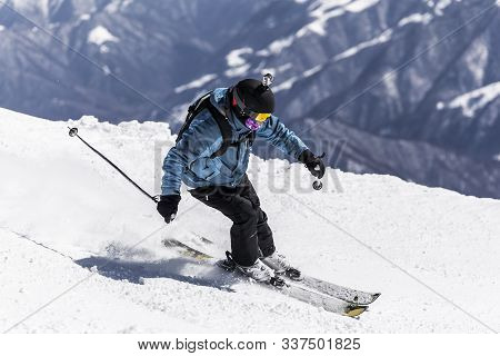 Skier In Blue Clothing Enjoying Winter Vacation. Skier Get Off The Track On Fresh Snow In Beautiful