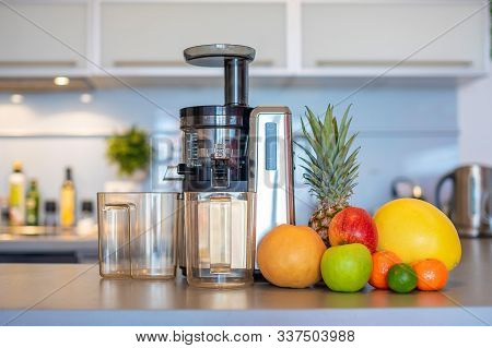 Making Fruit Juice With Juicer Machine At Home In Kitchen, Healthy Eating Lifestyle Concept