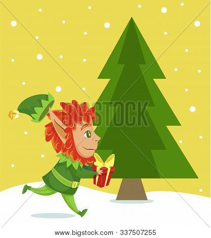 Xmas Character With Present In Hands Passing Christmas Tree. Elf Running With Gift Decorated With Wr