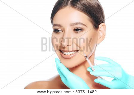 Female Face With Mimic Wrinkles Near Mouth While Beauty Injections. Botulinum Toxin Injection For Re