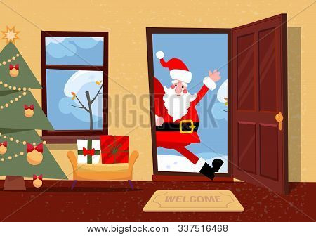 Santa Claus Looks In Doorway. Hallway Interior With Christmas Tree, Gifts In Boxes Inside. Santa Com
