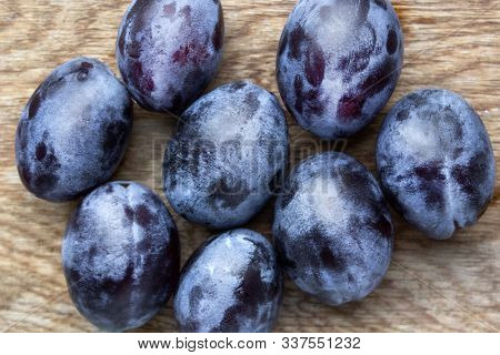 Fresh Organic Plums On Wooden Background