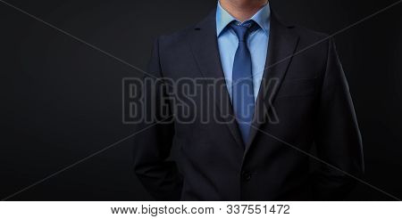 Man In Black Blue Suit With Tie