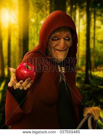 Fairytale Evil Old Witch Holding A Poisoned Red Apple At Twilight In A Deep Forest, Scene From The T