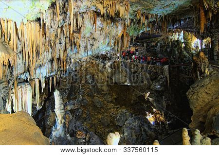 Amazing Landscape View Of Postojna Cave. Ancient Formations Inside Cave With Stalactites And Stalagm