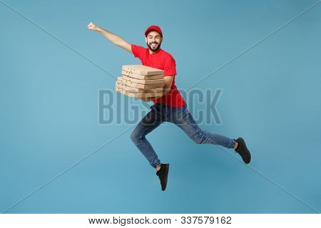 Delivery Man In Red Workwear Giving Food Order Pizza Boxes Isolated On Blue Background, Studio Portr