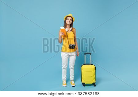 Traveler Tourist Woman In Yellow Summer Casual Clothes Hat Hold Tickets Bag Camera Isolated On Blue