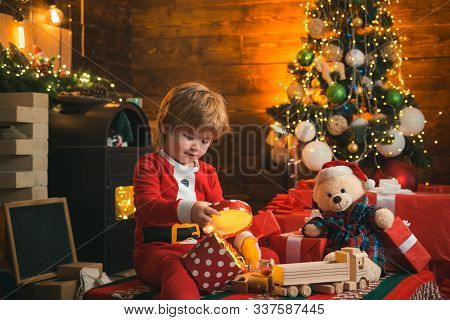 Check Contents Of Christmas Stocking. Christmas Eve. Happy Holiday. Holiday. Xmas Tree. Child At Chr