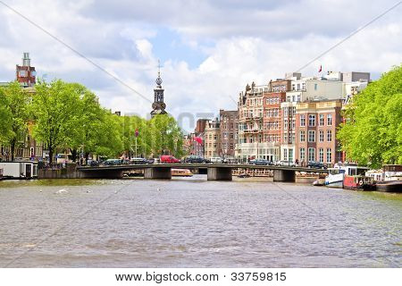 City scenic from Amsterdam with the Munt tower in the Netherlands
