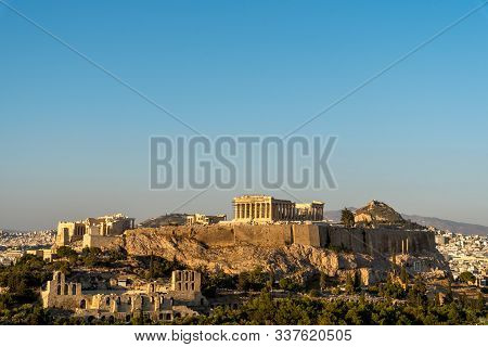 The Acropolis And Parthenon Under A Blue Cloudless Sky Viewed From Phillipappas Hill