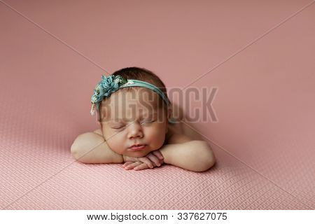 Portrait Of Baby Girl. Newborn Girl Sleeps And Dreams.  Place For Your Text. Not Live Style.  Studio