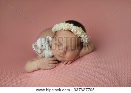 Adorable Cute Newborn Baby Girl With Knitted Toy Easter Bunny In Hands. Lovely Child Playing With Pl
