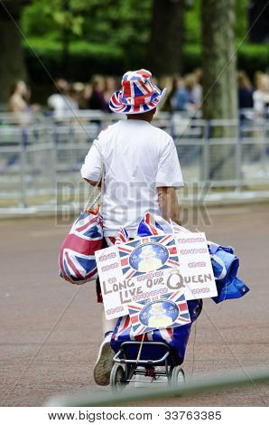 LONDON, UK - JUNE 1: A spectator on the Mall for the Queen's Diamond Jubilee on June 1, 2012 in London. The main events will take place from June 2 until June 5.