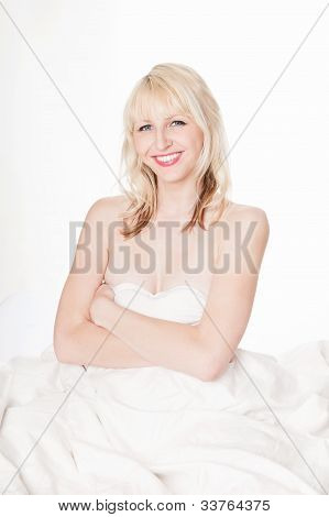 Beautiful Nude Woman Hiding Behind Bedclothes