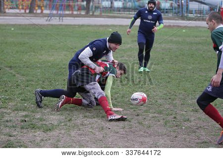 Odessa, Ukraine November 24, 2019: Local Rugby Clubs Engaged In Fierce Fight On Green Unequipped Fie