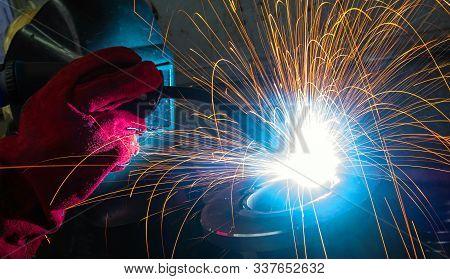 Welding With Sparks By Process Fluxed Cored Arc Welding , Industrial Steel Welder Part In Factory We