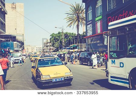 Dakar, Senegal - November 11, 2019: People Working And Traffic At Senegal Capital Dakar, West Africa