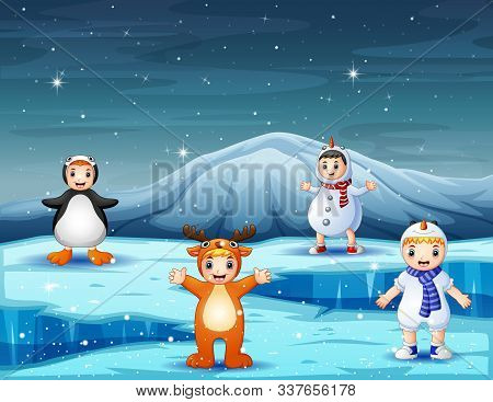 Cute Children In Different Costume On Icy Landscape