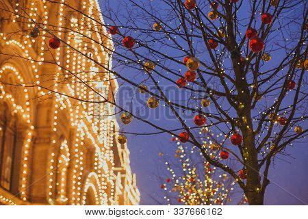 Christmas Decoration Details In The City Streets For New Year Holidays: Red And Gold Balls On A Tree