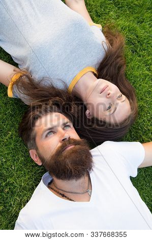 Youth And Freedom. Couple In Love Relaxing Lay Meadow. Freshness And Peace. Hipster Bearded Man And