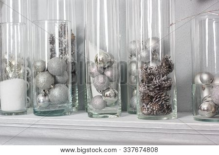 Chirstmas Decoration With The Pine Cones And Balls In Glass Bulbs.