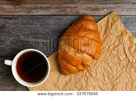 Morning With A Croissant. The Beginning Of The Morning. Fresh French Croissant. Coffee Cup And Fresh