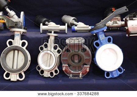 Moscow, Rf, 10.24.2019: Butterfly Valve. Cast Iron Center Throttle. Stop Valves, Worm Valve For Prod