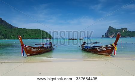 Two Long Tail Boats On The Beautiful And Peaceful Beach At Phi Phi Island, In Phi Phi, Thailand 23/1