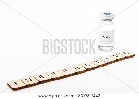Vaccine concept showing a medical vial with a Vaccine label on a white background along with a sign reading Ineffective poster