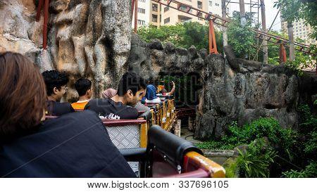 Subang Jaya, Malaysia - November 28, 2019: Tourist Riding A Rollercoaster At Sunway Lagoon Theme Par