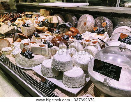 Lviv, Ukraine - December 25, 2018: Dutch Cheeses, Edam, Gouda, Whole Round Wheels On A Wooden Shelf,