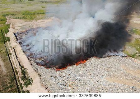 Burning Trash. Fire At The Landfill. Burning Garbage. Garbage Dump, Top View Of The Trash. Landfill.