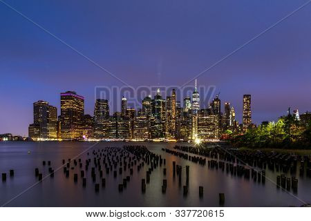 The Skyline Of Nyc Under A Colored Evening Sky