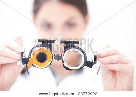 Optometrist holding a eye test glasses.
