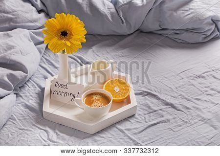 Tray With Coffee, Milk, Orange, Yellow Flower In A Vase And Card With Text Good Morning