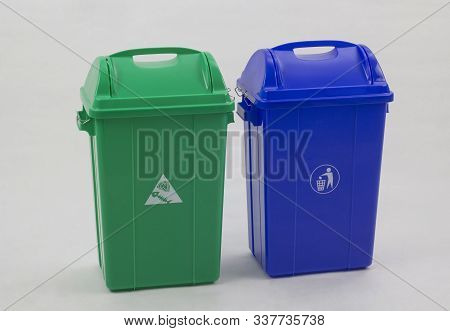 Different Colored Trash Bins For Collecting Various Type Of Garbage Isolated On White Background