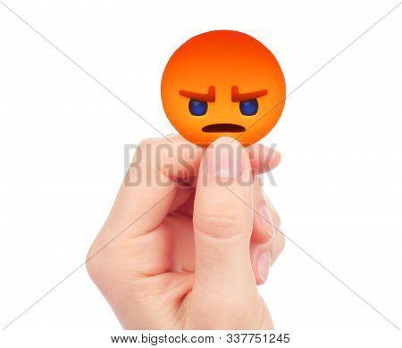 Kiev, Ukraine - May 15, 2019: Hand Holds New Facebook Angry Empathetic Emoji Reaction, Printed On Pa