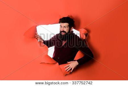 Businessman Breaks Through Paper. Bearded Man Looking Through Paper Hole. Breakthrough Paper Hole Wi