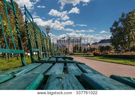 Green Chairs In The Volksgarten (people's Garden) In Vienna With A View On The State Theater Burgthe