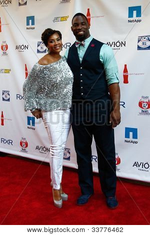 NEW YORK-MAY 31: Actress Vivica A. Fox and New York Giants player Justin Tuck attend the 4th annual Tuck�s Celebrity Billiards Tournament at Slate on May 31, 2012 in New York City.