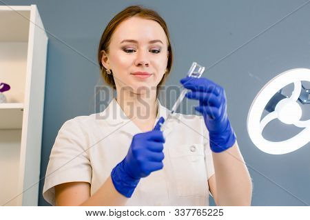 Hair Beauty, Mesotherapy: A Beautician Trichologist Doctor Preparing Medication For A Needle Mesothe