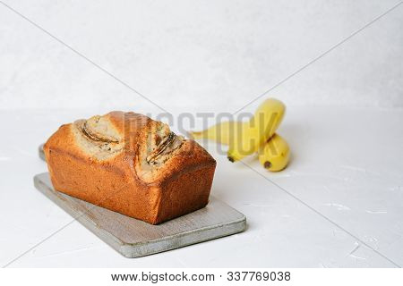 Banana Bread With Bananas On A Light Background Copy Space.