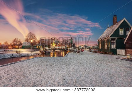 Small Mill And Typical Zaanse Houses On The Zaans Schans In Winter Located On The River De Zaan In T